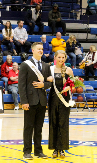 Homecoming King Kyle Cates and Allison Burress smile for the crowd after being crowned.