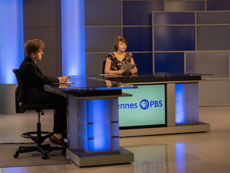 Anchors report the news during a recent newscast in the newly renovated studio.