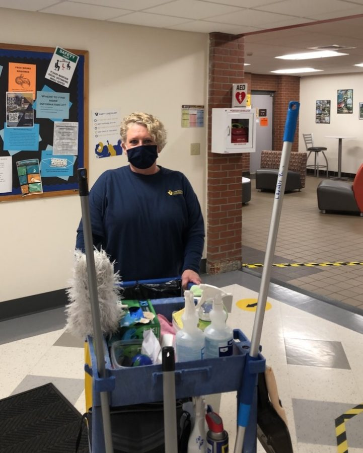 Frankie Hussey gets ready to clean the hallways of Godare Hall.