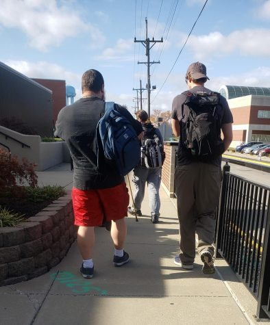 Students walk through campus on a recent afternoon. Many students are facing challenges during this unusual semester.