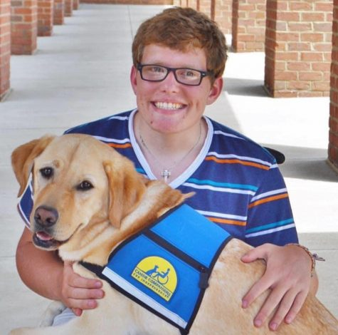 Parker Timberman and his service dog Herb.