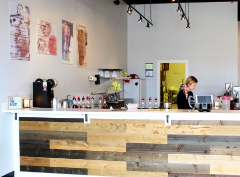 A cafe worker prepares an order at 6th Street Nutrition.