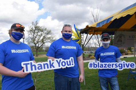 Students stopped by a tent set up for Blazers Give day.