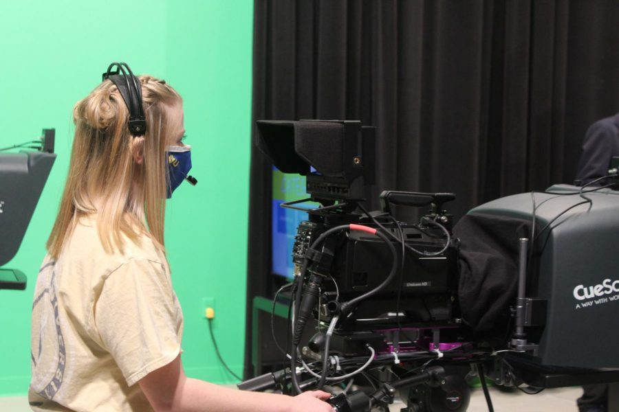 A Broadcasting student runs the camera during a recent taping of Trailblazer Trivia.