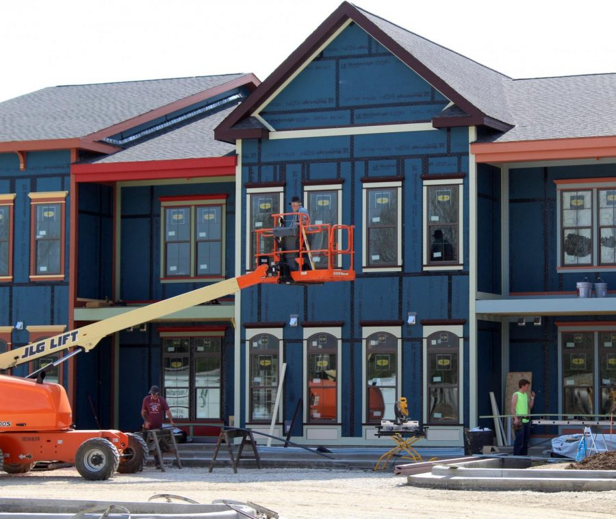 Workers continue to make updates on the second phase of the French Quarter apartment complex.