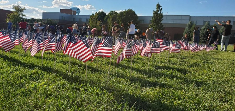 Students look on during a ceremony to create a flag tribute wall in honor of the anniversary of the 9/11 attacks.