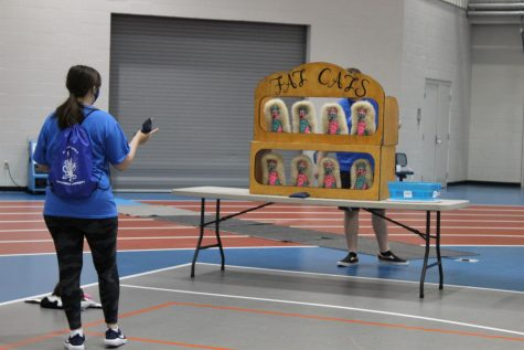 A student tries one of the carnival games during Blazerpalooza.