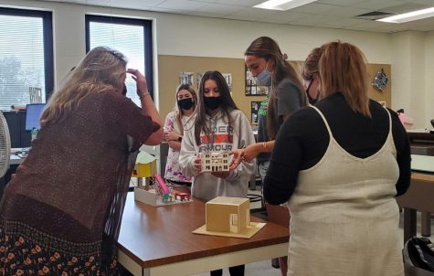 Students work on an interior design project during a recent class meeting.